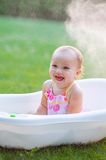 Little girl bathes in a bath in park Royalty Free Stock Photos