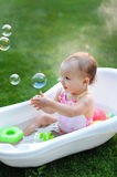 Little girl bathes in a bath with soap bubbles Stock Photography