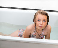Little girl bathes in a bathroom. Royalty Free Stock Photography