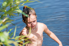 Little girl bathes in lake Royalty Free Stock Photos