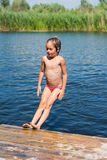 Little girl bathes in lake Royalty Free Stock Image