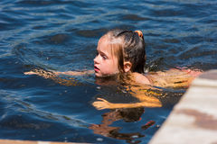 Little girl bathes in lake Royalty Free Stock Images