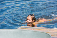 Little girl bathes in lake Stock Photos