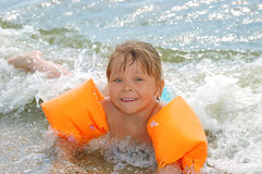 Little girl bathes in waves Stock Photography