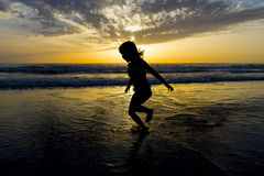 Little girl bathing on the beach at dusk Royalty Free Stock Photography
