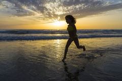 Little girl bathing on the beach at dusk Royalty Free Stock Images