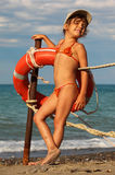 Little girl in bathing suit standing on beach Royalty Free Stock Photos