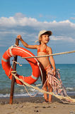 Little girl in bathing suit standing on beach royalty free stock photography