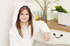 Little girl in a bathrobe Stock Image