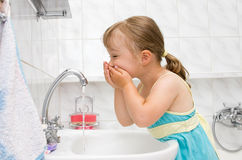 Little girl in bathroom Royalty Free Stock Image