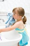 Little girl in bathroom Stock Photography