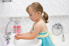 Little girl in bathroom stock photography