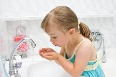 Little girl in bathroom Royalty Free Stock Photo