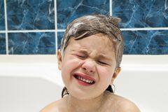 Little girl in bathroom washing her hair. The symbol of purity a. Nd hygiene education Stock Image