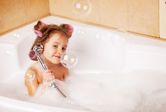 Little girl in the bathtub Stock Images