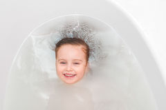 Little girl in a bathtub, diving, topview Royalty Free Stock Images