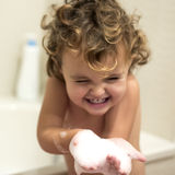 Little girl in the bathtub Stock Photos