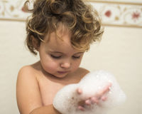 Little girl in the bathtub Royalty Free Stock Photos