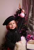 Little girl with bauble Stock Images
