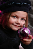 Little girl with bauble Royalty Free Stock Photo