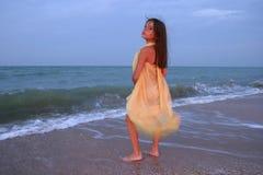 Little girl on the beach Stock Image