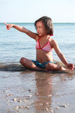 Little girl in the beach Stock Photo