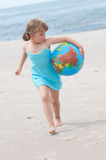 Little girl  at the beach Stock Images