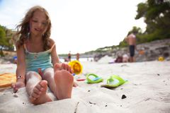 Little girl on a beach. Royalty Free Stock Images