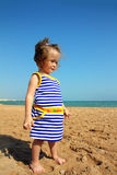 Little girl on beach Stock Image