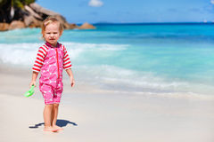 Little girl at beach Stock Photos