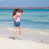 Little girl on a beach Stock Images