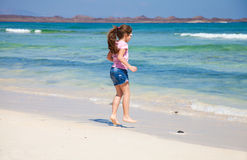 Little girl on a beach Stock Image
