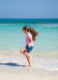 Little girl on a beach Royalty Free Stock Images