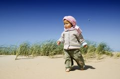 Little girl at the beach. Sweet little girl walking at the beach Stock Images