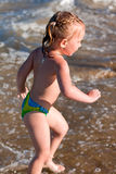 Little girl at the beach. On a sunny day Royalty Free Stock Photos