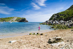 Little Girl On The Beach. Playing In Staying In The Water royalty free stock photos