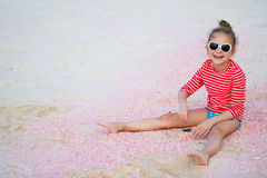 Little girl at beach Stock Images