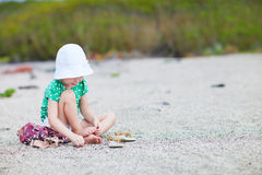 Little girl at beach. Adorable little girl an a wild beach Stock Photos