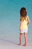 Little girl at beach. Back view of a little girl at beach during summer vacation Royalty Free Stock Images