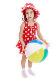 Little girl on the beach with big inflatable ball Stock Image