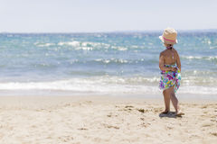 Little girl on the beach Stock Photos