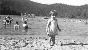 Little Girl on the Beach. Circa 1942. Taken at a lake somewhere in or near Farmville, Virginia Royalty Free Stock Image