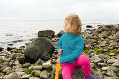 Little girl on beach is looking to the sea Royalty Free Stock Photography