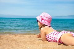 Little girl on beach Stock Images