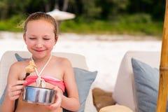 Little girl at beach picnic royalty free stock photos