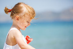 Little girl on the beach Stock Images