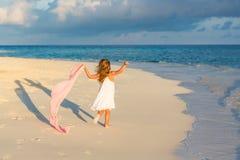 Little girl on the beach Stock Photo