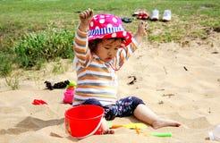 Little girl on beach Stock Photos