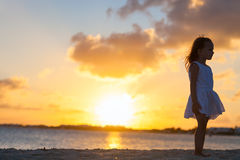 Little girl at a beach. Silhouette of adorable little girl on a beach at sunset Stock Photography