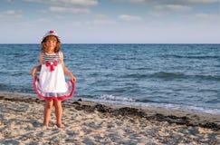 Little girl on beach summer scene Stock Images